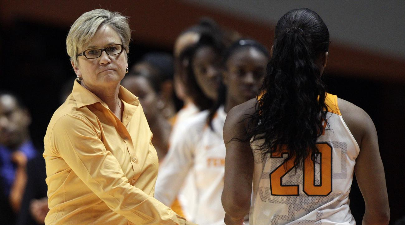 FILE - In this Dec. 6, 2015, file photo, Tennessee head coach Holly Warlick pats guard Te'a Cooper (20) as she leaves the game in the second half of an NCAA college basketball game against the Virginia Tech in Knoxville, Tenn. Now that Tennessee finally h