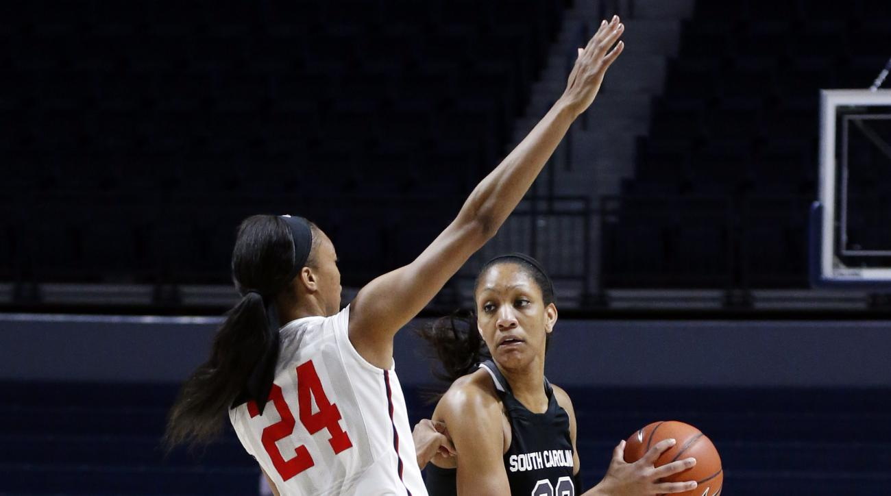South Carolina forward A'ja Wilson (22) looks for a teammate to pass to while Mississippi forward Bretta Hart (24) defends in the first half of an NCAA college basketball game in Oxford, Miss., Thursday, Feb. 25, 2016. (AP Photo/Rogelio V. Solis)