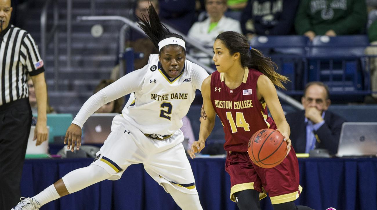 Boston College's KaileyEdwards (14) moves by Notre Dame's Arike Ogunbowale (2) during the second half of Notre Dame's 70-58 win in an NCAA college basketball game Saturday, Feb. 27, 2016, in South Bend, Ind. (AP Photo/Robert Franklin)