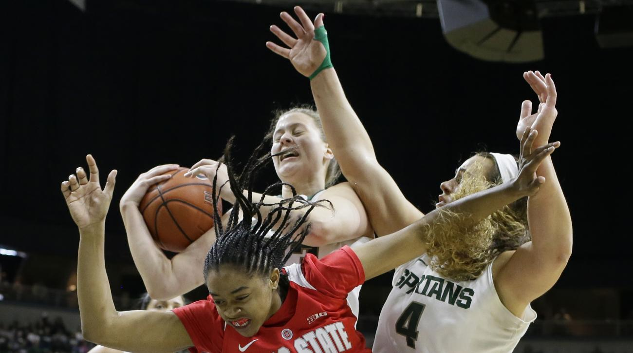 Michigan State center Jenna Allen, back left, grabs a rebound in front of center Jasmine Hines (4) and Ohio State guard Asia Doss (20) during the first half of an NCAA college basketball game, Saturday, Feb. 27, 2016, in East Lansing, Mich. (AP Photo/Carl