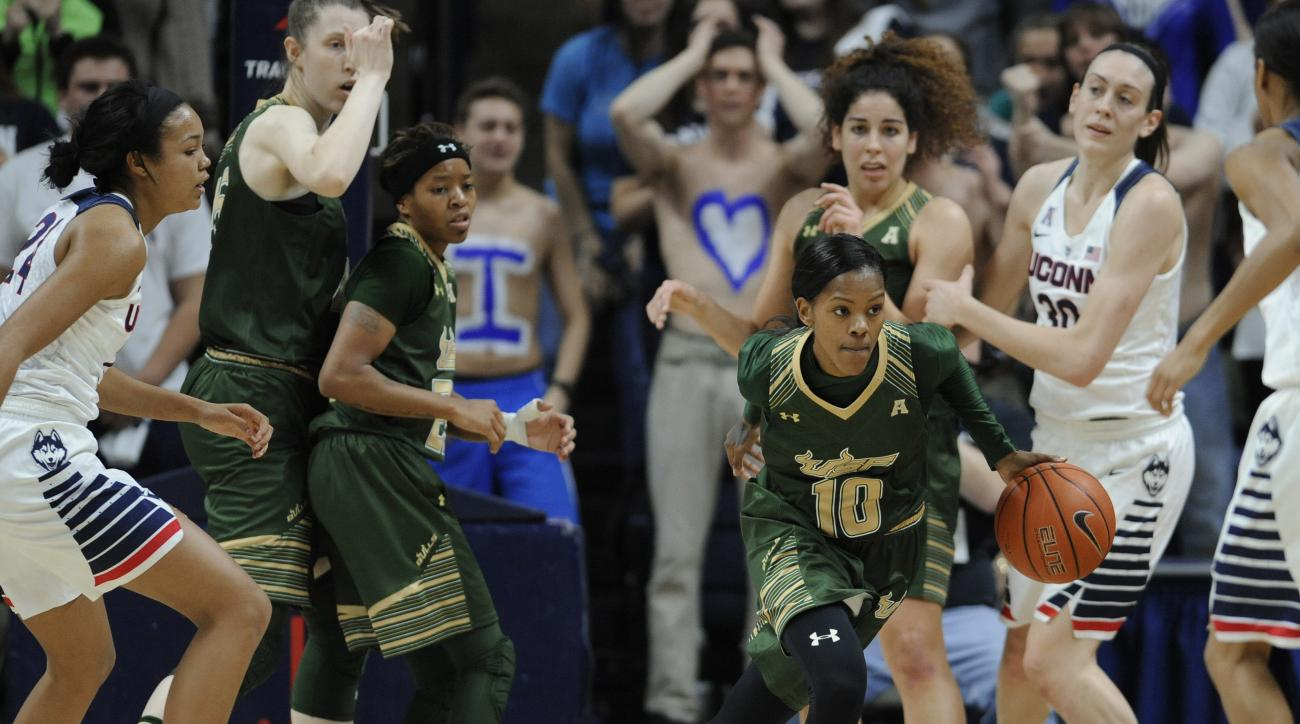 South Florida's Courtney Williams (10) takes off after snagging a rebound in the first half of an NCAA college basketball game against Connecticut, Monday, Feb. 29, 2016, in Storrs, Conn. (AP Photo/Jessica Hill)