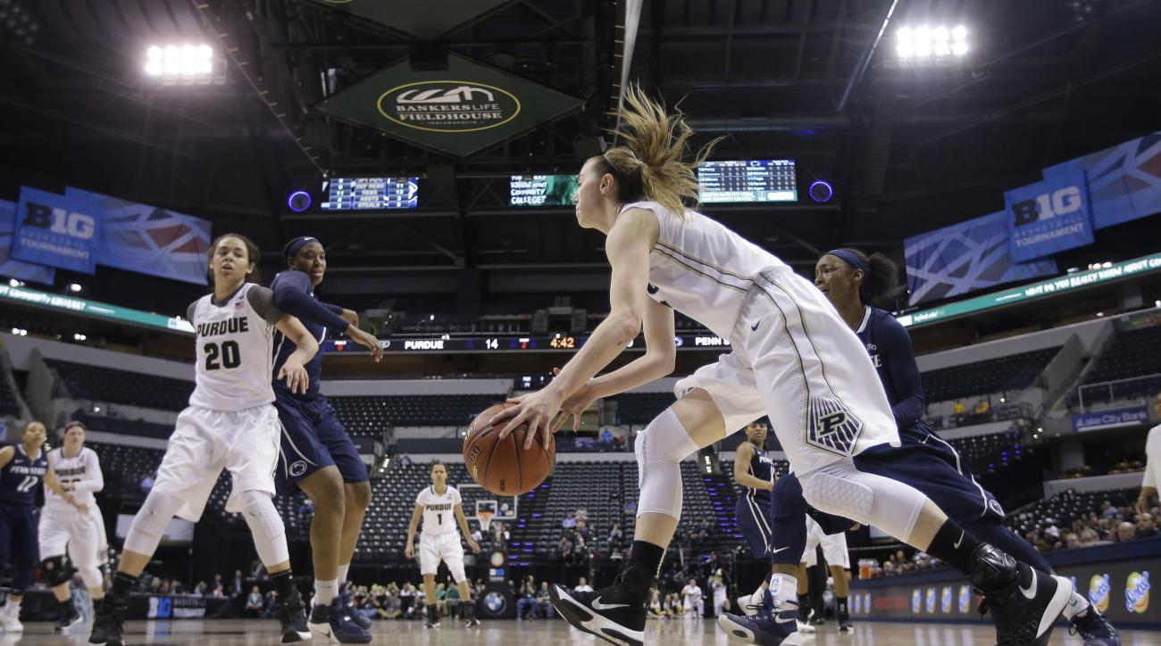 Purdue's Bridget Perry (13) goes to the basket past Penn State's Brianna Banks, right rear, during the first half of an NCAA college basketball game at the Big Ten women's tournament Thursday, March 3, 2016, in Indianapolis. (AP Photo/Darron Cummings)