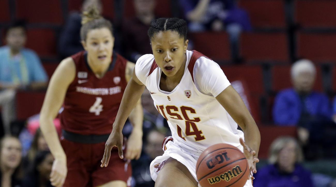Southern California's Sadie Edwards, right, drives in front of Washington State's Louise Brown during the first half of an NCAA college basketball game in the Pac-12 women's tournament, Thursday, March 3, 2016, in Seattle. (AP Photo/Elaine Thompson)
