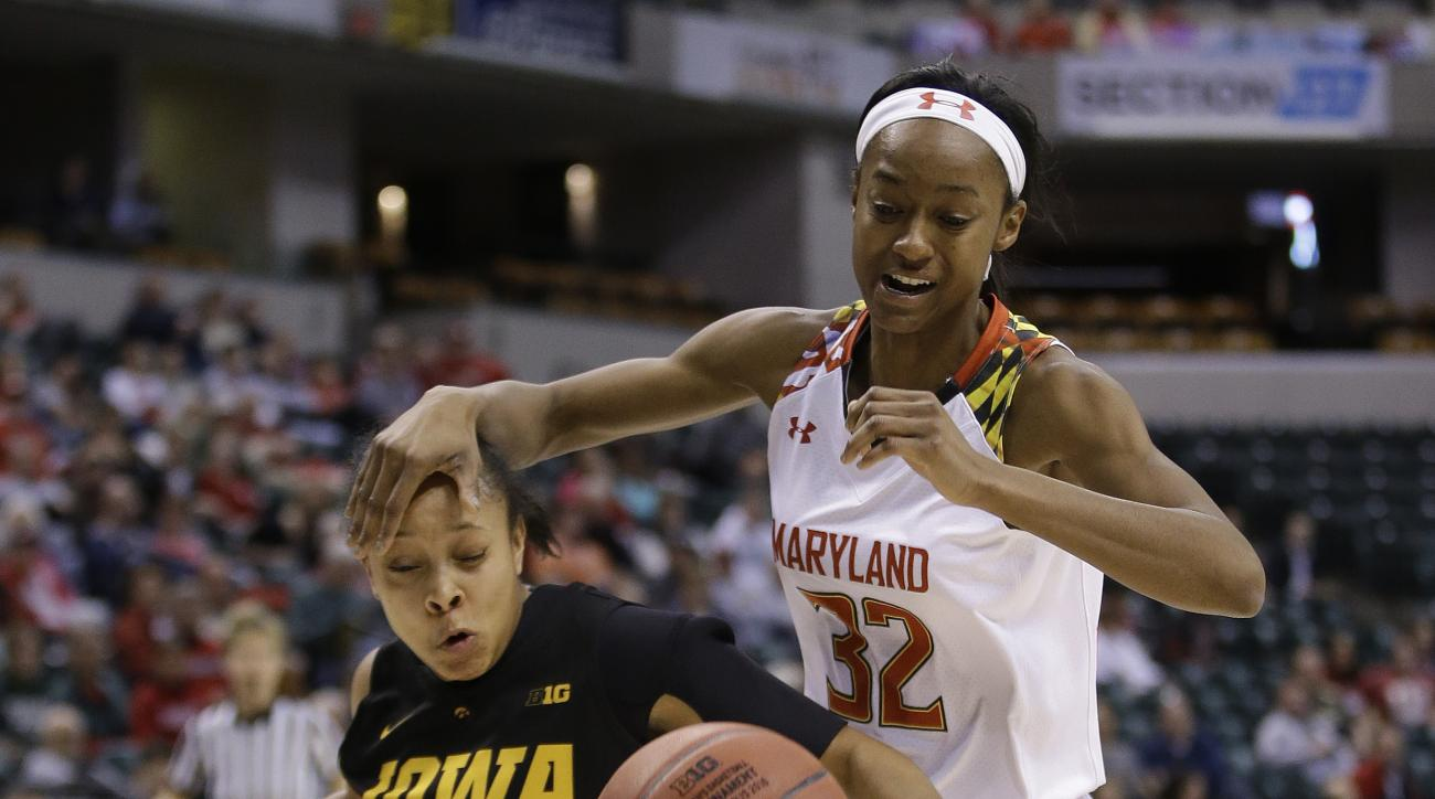 Iowa's Tania Davis (11) and Maryland's Shatori Walker-Kimbrough (32) go for a loose ball during the first half of an NCAA college basketball game at the Big Ten Conference tournament Friday, March 4, 2016, in Indianapolis. (AP Photo/Darron Cummings)