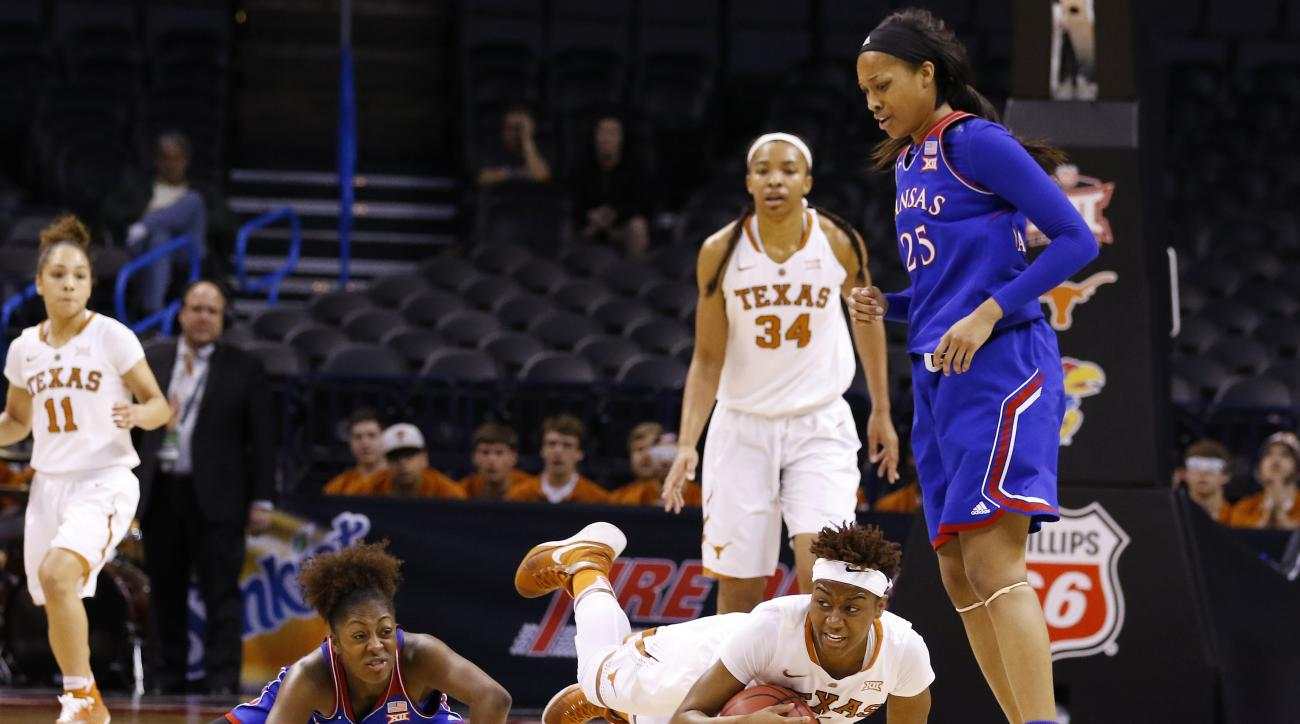 Texas forward Jordan Hosey dives for a loose ball in front of Kansas forward Caelynn Manning-Allen (25) during the first half of an NCAA college basketball game in the Big 12 Conference women's tournament in Oklahoma City, Saturday, March 5, 2016. (AP Pho