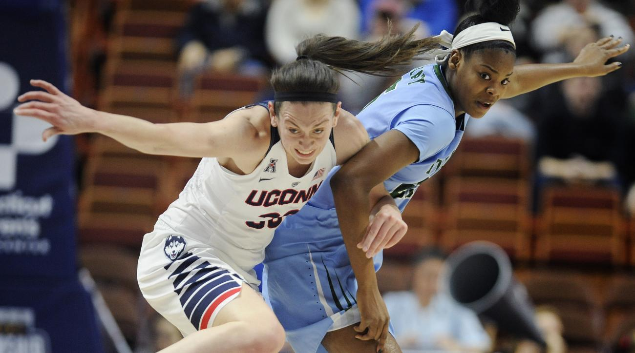 Connecticut's Breanna Stewart steals the ball from Tulane's Harlyn Wyatt, right, during the first half of an NCAA college basketball game in the American Athletic Conference tournament semifinals at Mohegan Sun Arena, Sunday, March 6, 2016, in Uncasville,