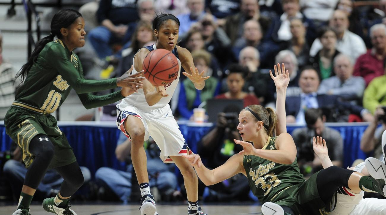 Connecticut's Moriah Jefferson, center, intercepts a pass for a steal from South Florida's Kitija Laksa, right, to Courtney Williams, left, during the first half of an NCAA college basketball game in the American Athletic Conference tournament finals at M