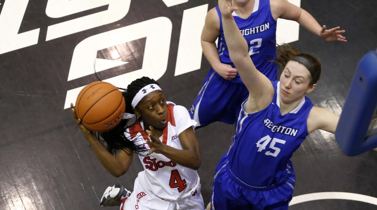 St. John's 's Aaliyah Lewis (4) shoots over Creighton 's Audrey Faber (45) during the first half of the Big East Conference NCAA women's college basketball tournament championship game, Tuesday, March 8, 2016, in Chicago. (AP Photo/Charles Rex Arbogast)