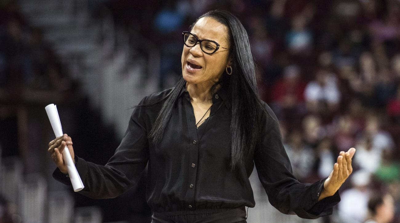 FILE - In this Dec. 22, 2015, file photo, South Carolina head coach Dawn Staley gestures to the bench during the first half of an NCAA college basketball game against Elon, in Columbia, S.C. Women's college basketball coaches believe a set of rule changes