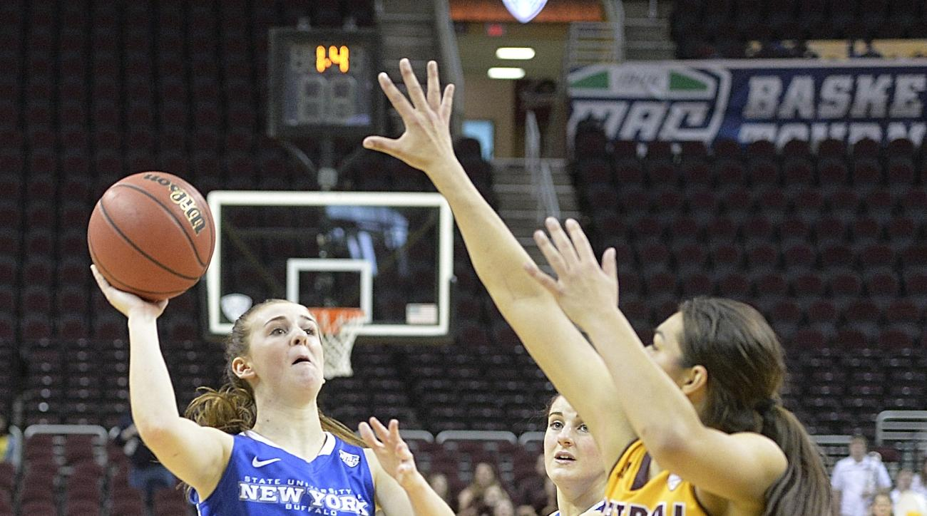 Buffalo's Stephanie Reid drives to the basket while scoring a last-second, game-winning basket in overtime  of an NCAA college basketball game against Central Michigan in the championship of the Mid-American Conference women's tournament, Saturday, March