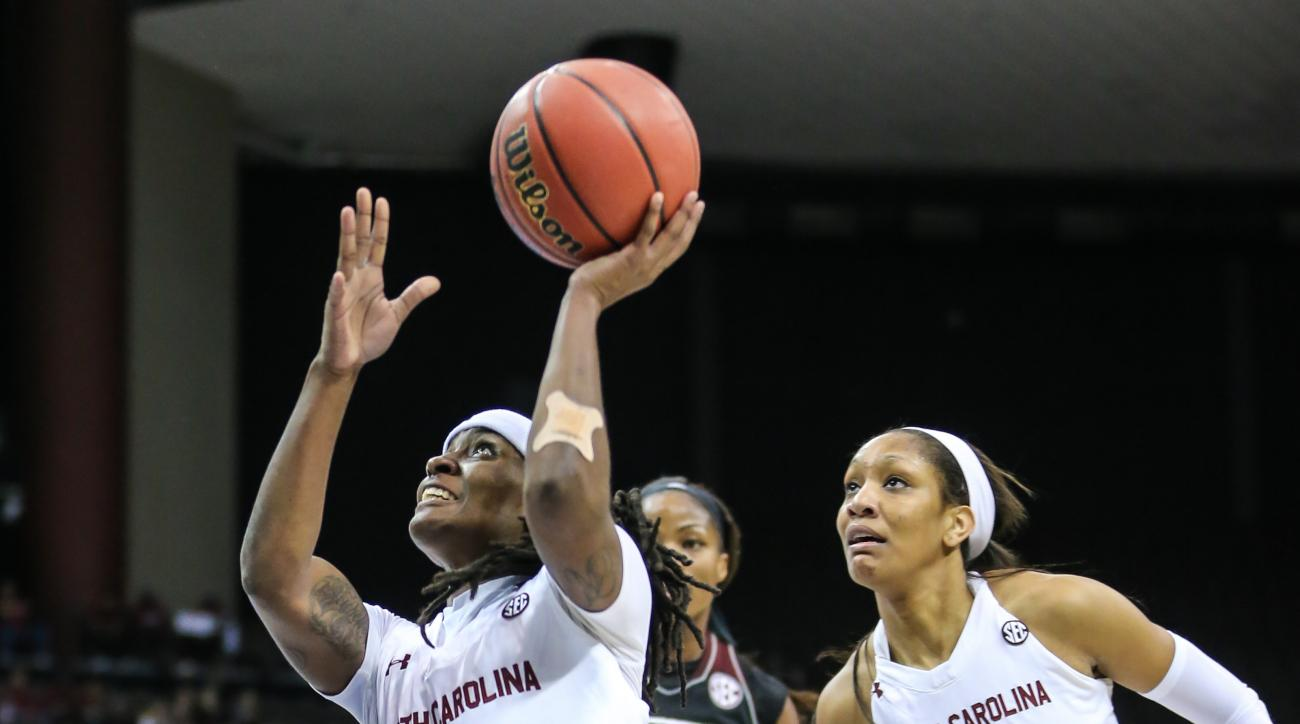 FILE- In this March 6, 2016, file photo, South Carolina guard Khadijah Sessions (5) shoots the ball in front of teammate A'ja Wilson (22) against Mississippi State during NCAA college basketball action in the Southeastern Conference women's tournament fin