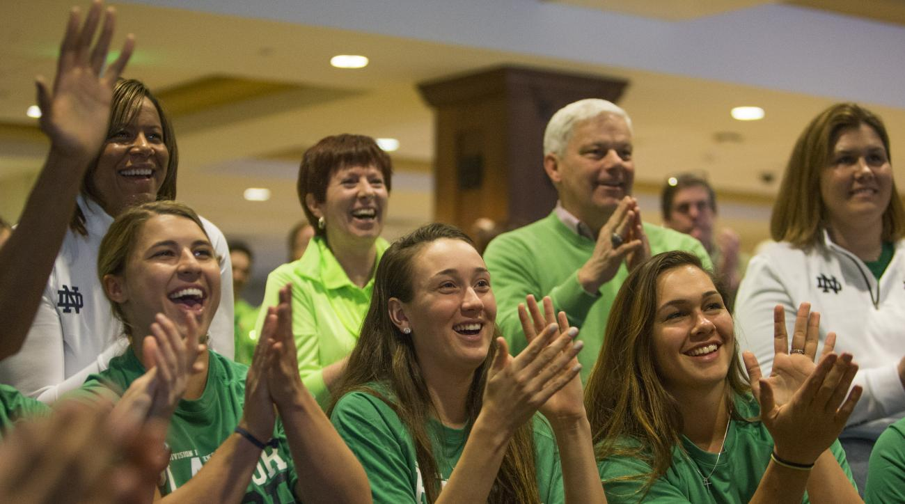 Notre Dame women's basketball players Hannah Huffman, left, Michaela Mabrey, center, and Kathryn Westbeld react as their placement as a No. 1 seed in the NCAA tournament is announced during the ESPN selection show on Monday, March 14, 2016, in South Bend,