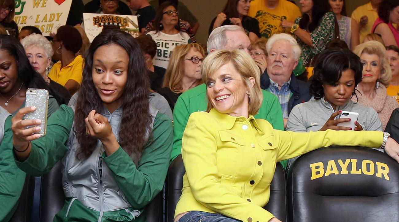 Baylor's Nina Davis, left, takes a selfie with head coach Kim Mulkey, right, while watching the women's NCAA college basketball tournament selection show in Waco, Texas, Monday, March 14, 2016. Baylor was selected as a No. 1 seed and will play Idaho in th