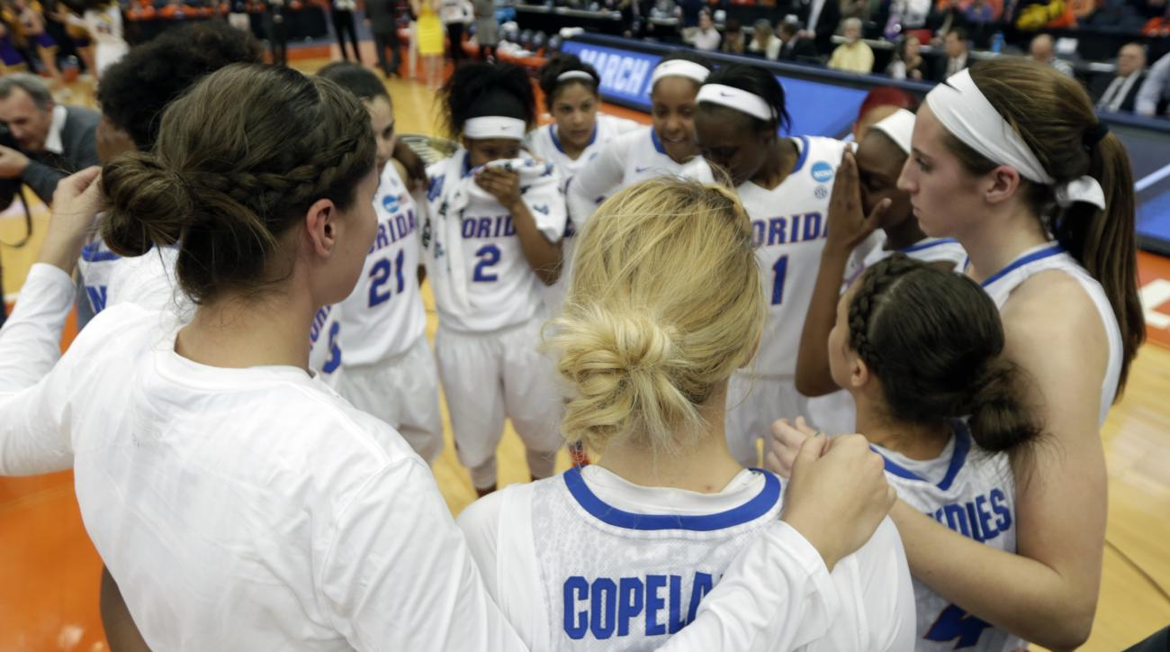 Florida players gather after their 61-59 loss to Albany in a first-round women's college basketball game in the NCAA Tournament on Friday, March 18, 2016, in Syracuse, N.Y. (AP Photo/Mike Groll)