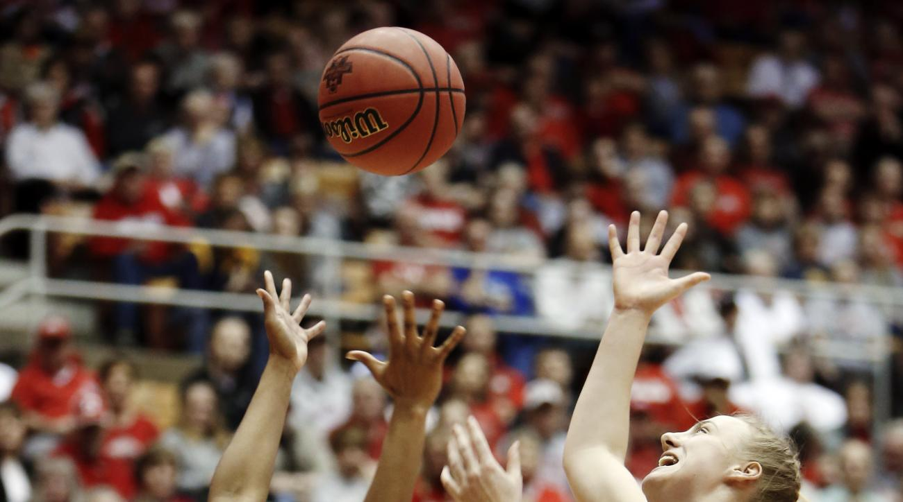 Buffalo's Katherine Ups, right, and Ohio State's Kelsey Mitchell fight for a rebound during a first-round women's college basketball game in the NCAA Tournament Friday, March 18, 2016, in Columbus, Ohio. (AP Photo/Jay LaPrete)