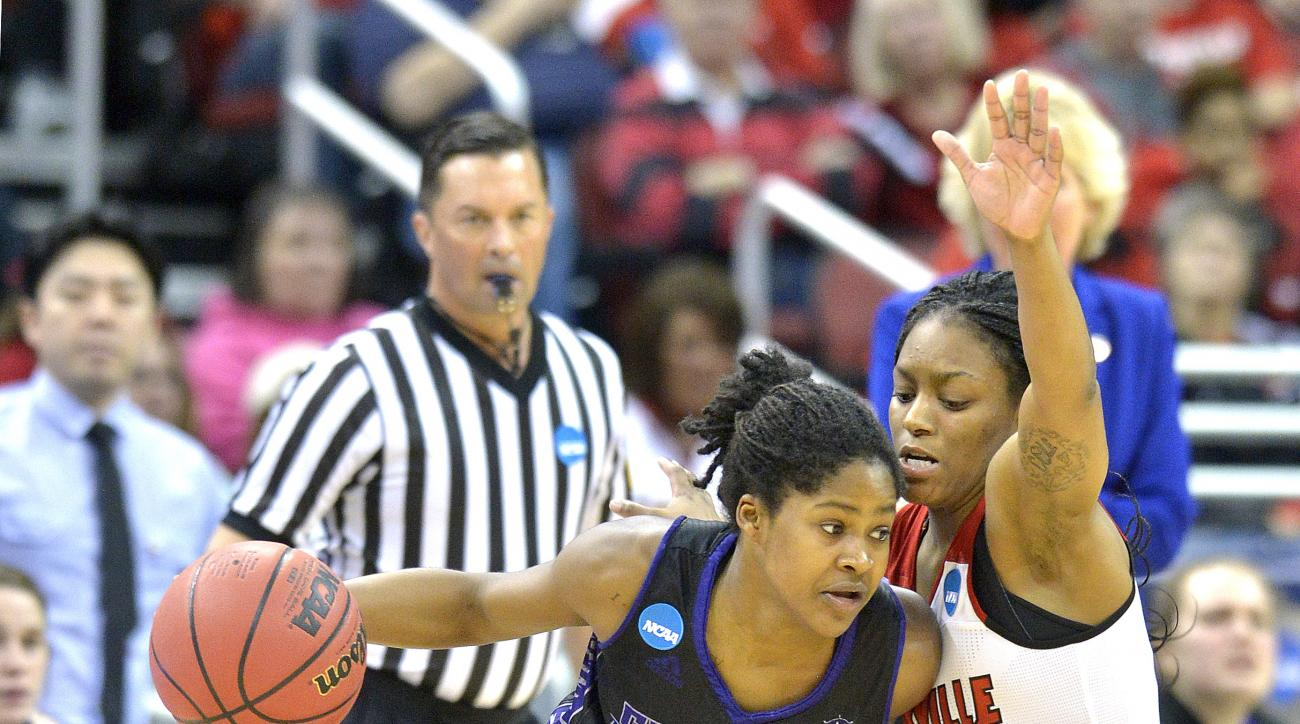 Central Arkansas's Jameka Watkins (5) attempts to drive past Louisville's Taja Cole (5) during the second half of a first-round women's college basketball game in the NCAA Tournament in Louisville, Ky., Friday, March 18, 2016. Louisville won 87-60. (AP Ph