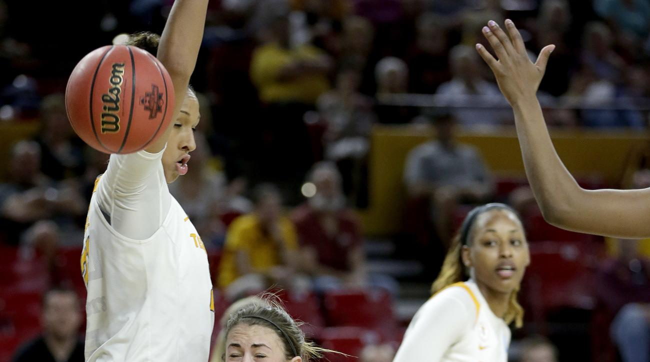 Green Bay guard Kaili Lukan, right, falls as she is fouled as Tennessee center Mercedes Russell defends during the second half of a first-round women's college basketball game in the NCAA Tournament, Friday, March 18, 2016, in Tempe, Ariz. Tennessee won 5