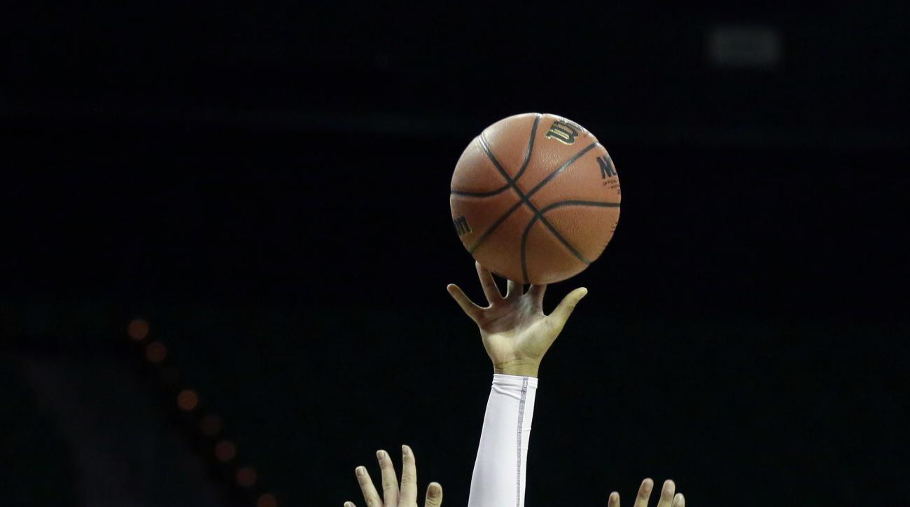 St. John's guard Kimberly Spruill (5) shoots against Auburn forward Katie Frerking (13) during the first half of a first-round women's college basketball game in the NCAA Tournament Friday, March 18, 2016, in Waco, Texas. (AP Photo/LM Otero)