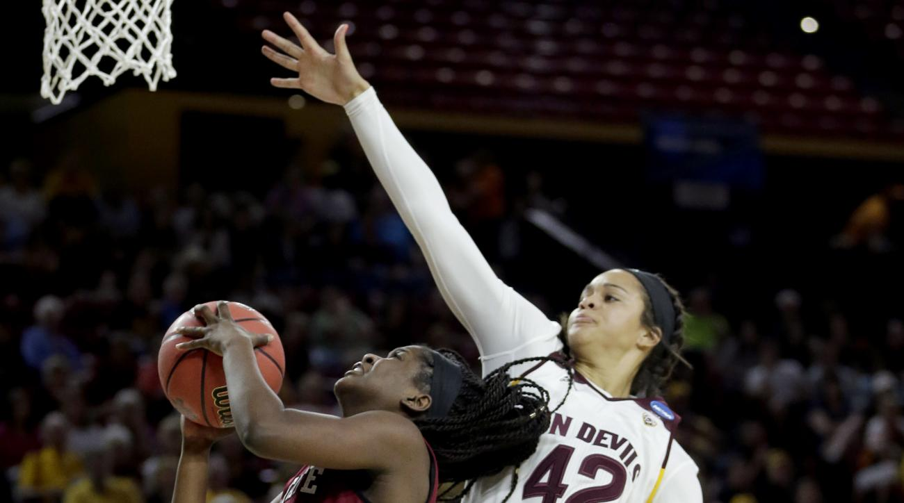 New Mexico State guard Moriah Mack drives past Arizona State forward Kianna Ibis (42) during the first half of a first-round women's college basketball game in the NCAA Tournament, Friday, March 18, 2016, in Tempe, Ariz. (AP Photo/Matt York)