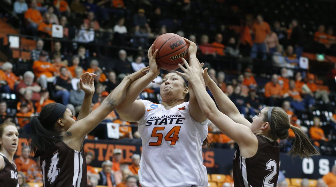 St. Bonaventure's Gabby Richmond's left, fouls Oklahoma State's Kaylee Jensen in the first half of a first-round women's college basketball game in the NCAA Tournament in Corvallis, Ore., on Friday March 18, 2016. (AP Photo/Timothy J. Gonzalez)