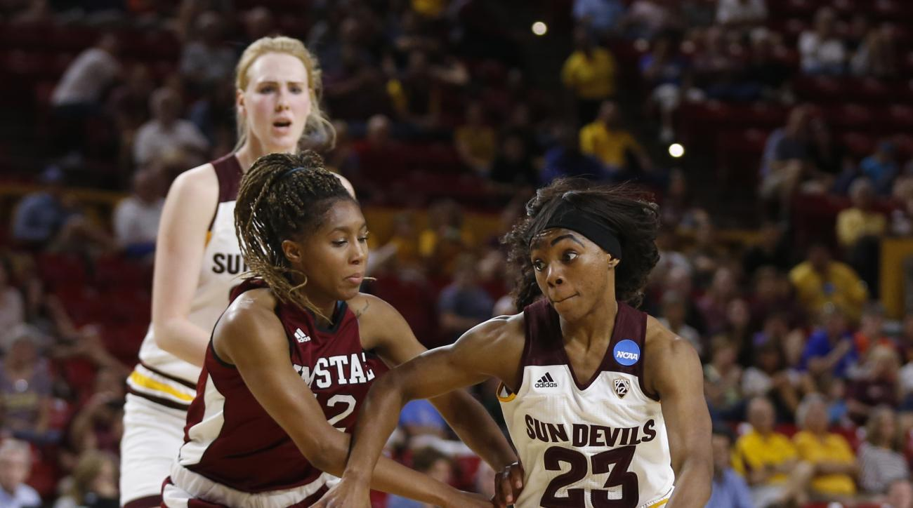 Arizona State's Elisha Davis (23) drives down the lane against New Mexico State's Zaire Williams (12) during a college basketball game in the NCAA women's tournament, Friday, March 18, 2016, in Tempe, Ariz. (Patrick Breen/The Arizona Republic via AP)