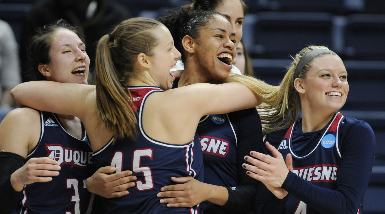 Duquesnes April Robinson, Emilie Gronas, Deva'Nyar Workman, and Chassidy Omogrosso, from the left, celebrate in the final seconds of a first round women's college basketball game against Seton Hall in the NCAA Tournament, Saturday, March 19, 2016, in Stor