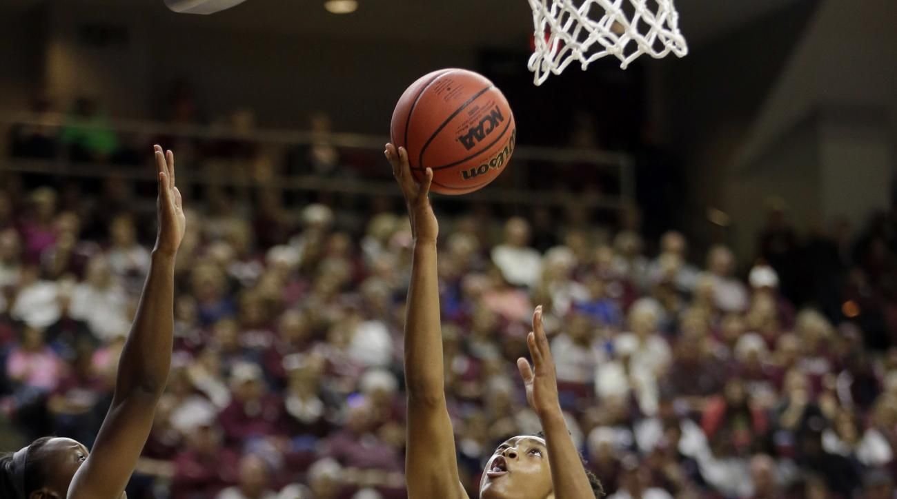 Texas A&M's Courtney Walker (33) shoots as Missouri State's Audrey Holt (13) and Tyonna Snow defend during the second half of a first-round women's college basketball game in the NCAA Tournament Saturday, March 19, 2016, in College Station, Texas. Texas A