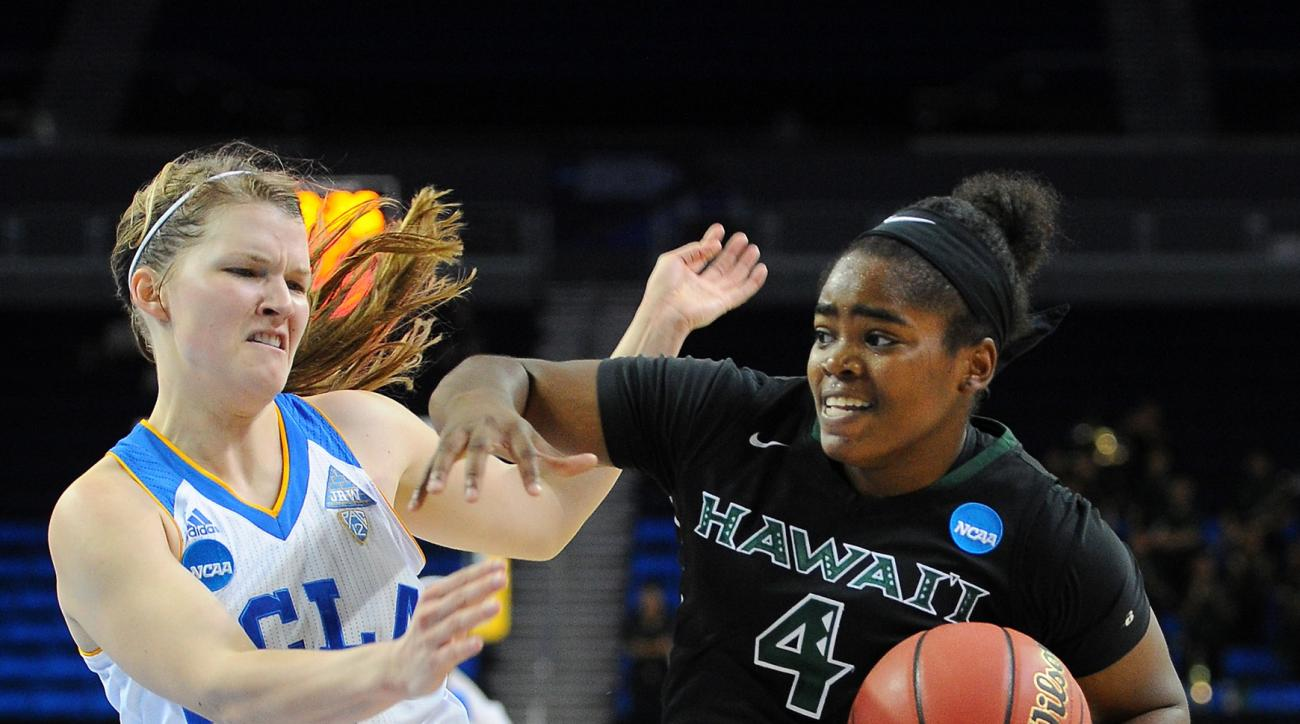 Hawaii's Briana Harris (4) is called for a push off against UCLA's Kari Korver during a first-round women's college basketball game in the NCAA Tournament in Los Angeles, Saturday, March 19, 2016. (AP Photo/Michael Owen Baker)
