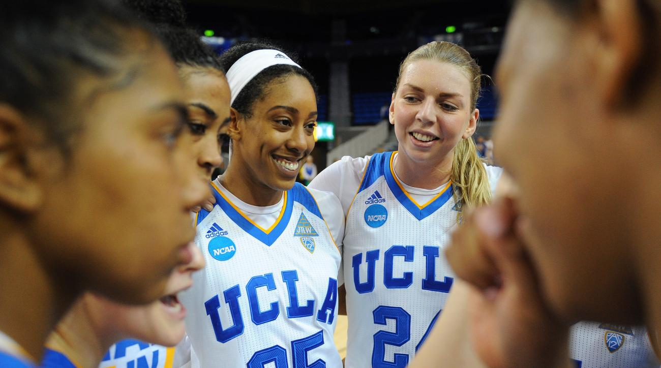 UCLA's Monique Billings (25) and Paulina Hersler smile in a team huddle after beating Hawaii 66-50 during a first-round women's college basketball game in the NCAA Tournament in Los Angeles, Saturday, March 19, 2016. (AP Photo/Michael Owen Baker)