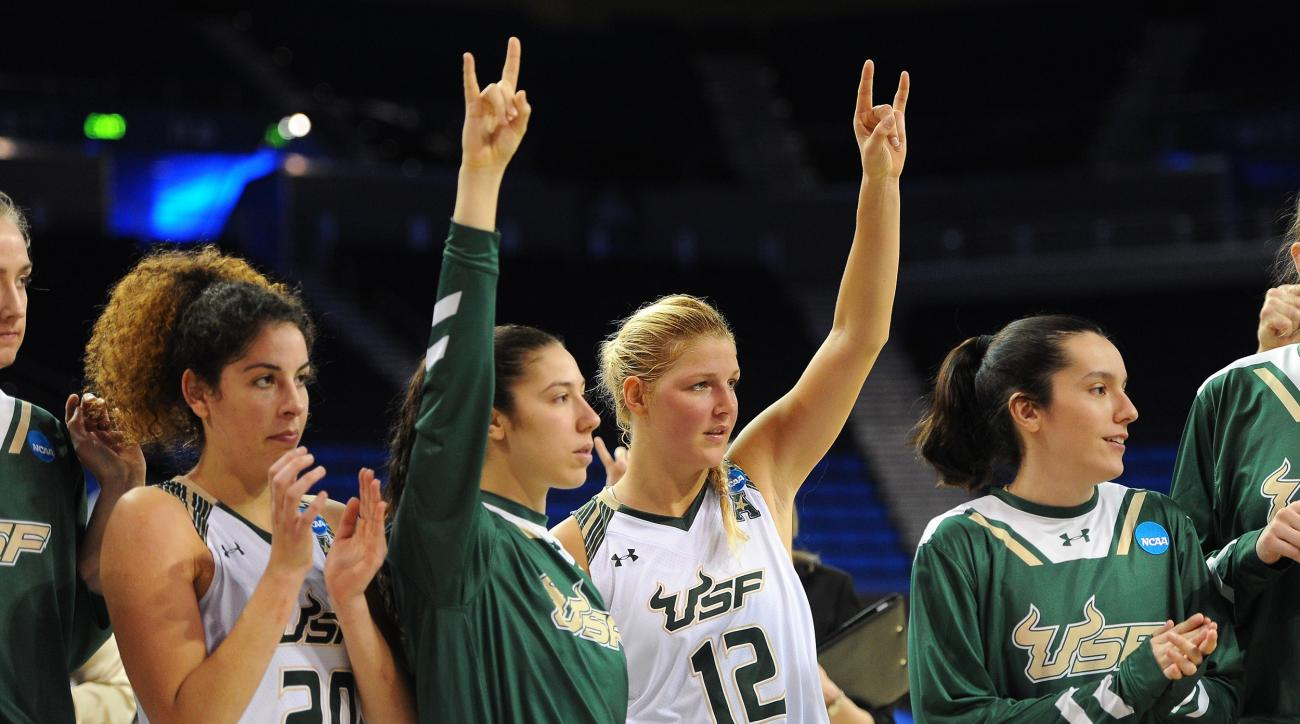 South Florida's Laia Flores, center left, and Maria Jespersen celebrate with teammates after defeating Colorado State in a first-round women's college basketball game in the NCAA Tournament in Los Angeles, Saturday, March 19, 2016. (AP Photo/Michael Owen