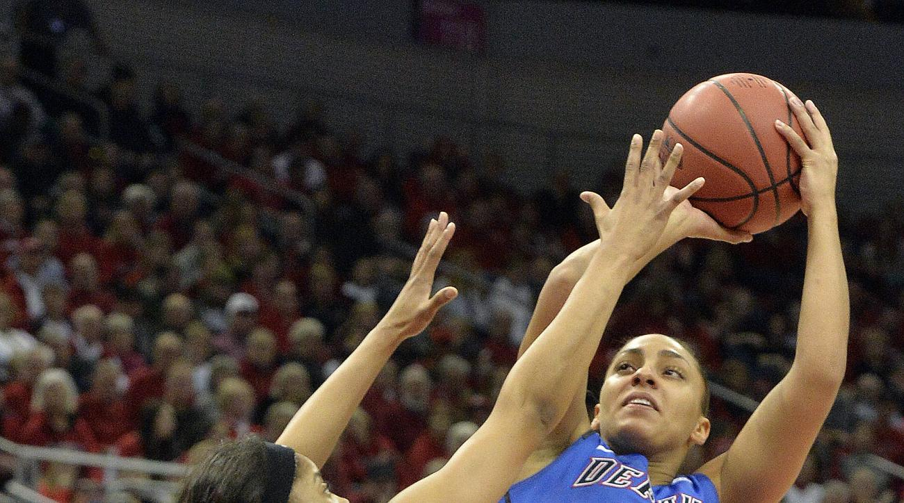 DePaul's Jessica January (14) shoots over Louisville's Arica Carter (11) during the first half of a second-round women's college basketball game in the NCAA Tournament in Louisville, Ky., Sunday, March 20, 2016. (AP Photo/Timothy D. Easley)