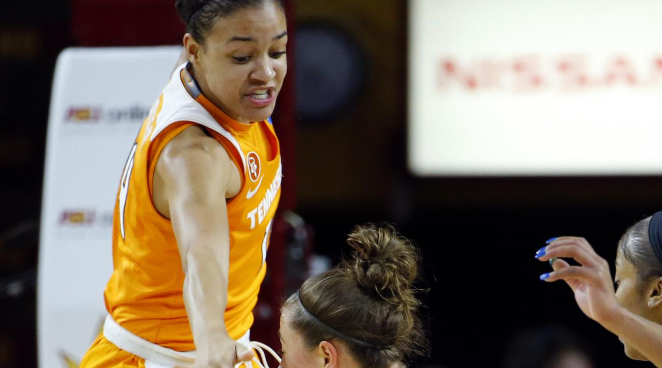 Tennessee guard Andraya Carter jumps trying to stop Arizona State guard Katie Hempen (0) during the first half of a second-round NCAA women's college basketball game, Sunday, March 20, 2016, in Tempe, Ariz. (AP Photo/Matt York)
