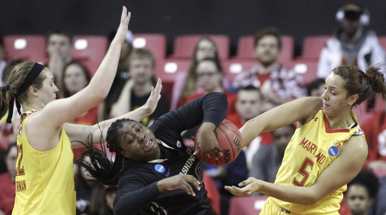 Washington forward/center Chantel Osahor, center, becomes entangled with Maryland forward Tierney Pfirman, left, and center Malina Howard as she tries to maintain possession in the first half of an NCAA college basketball game in the second round of the N