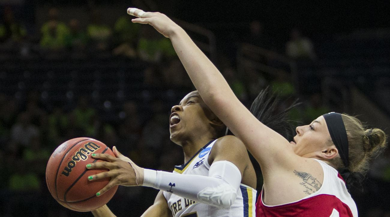 Notre Dames Lindsay Allen (15) goes up for a shot as Indianas JennAnderson (43) defends during the first half of a second-round women's college basketball game in the NCAA Tournament, Monday, March 21, 2016, in South Bend, Ind. (AP Photo/Robert Franklin)