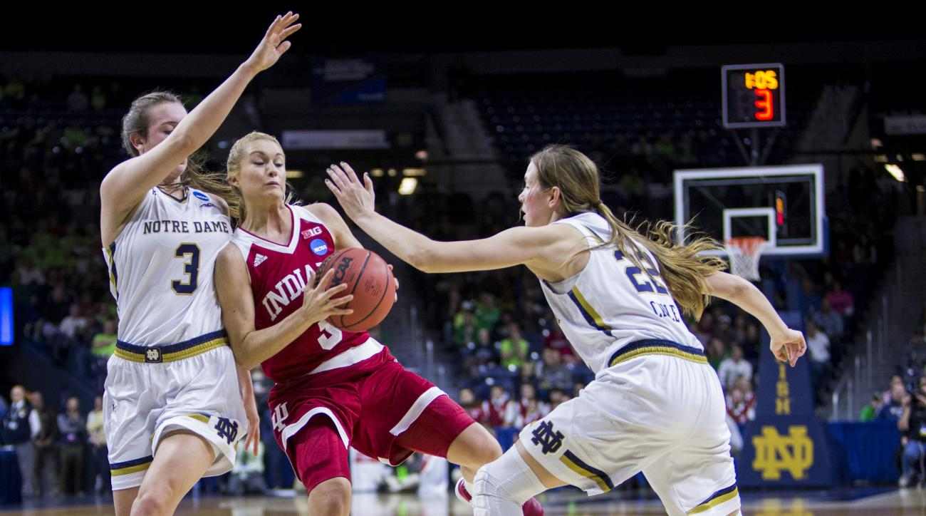 Indianas TyraBuss, center, gets pressure from Notre Dames Marina Mabrey,left, and Madison Cable, right, during the first half of a second-round women's college basketball game in the NCAA Tournament, Monday, March 21, 2016, in South Bend, Ind. (AP Photo/R