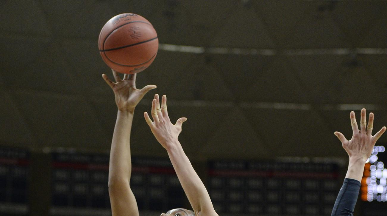 Connecticut's Morgan Tuck shoots against Duquesne's Amadea Szamosi (15) during the first half of a second round women's college basketball game in the NCAA Tournament, Monday, March 21, 2016, in Storrs, Conn. (AP Photo/Jessica Hill)
