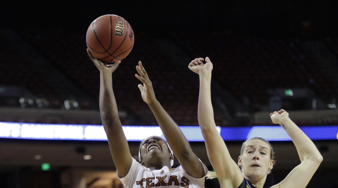 Texas guard Ariel Atkins (24) drives to the basket past Missouri guard Lindsey Cunningham (11) during a second-round women's college basketball game in the NCAA Tournament, Monday, March 21, 2016, in Austin, Texas. (AP Photo/Eric Gay)