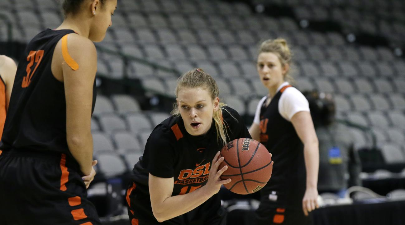 Oregon State guard Jamie Weisner (15) runs a drill with teammate forward Deven Hunter (32) during a college basketball practice in the regional semifinals of the women's NCAA Tournament, Friday, March 25, 2016, in Dallas. Oregon State takes on DePaul on S
