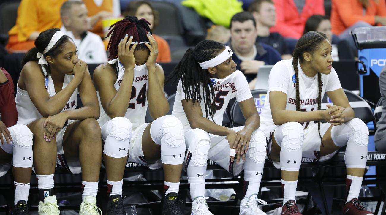 From left to right, South Carolina players Jatarie White, Sarah Imovbioh, Khadijah Sessions and Asia Dozier react on the bench during the second half of a regional semifinal women's college basketball game against Syracuse in the NCAA Tournament, Friday,