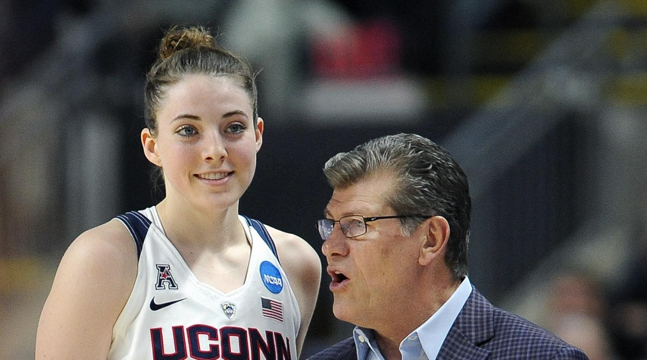Connecticut head coach Geno Auriemma, right, instructs Katie Lou Samuelson during the first half of an NCAA college basketball game against Mississippi State in the regional semifinals of the women's NCAA Tournament, Saturday, March 26, 2016, in Bridgepor