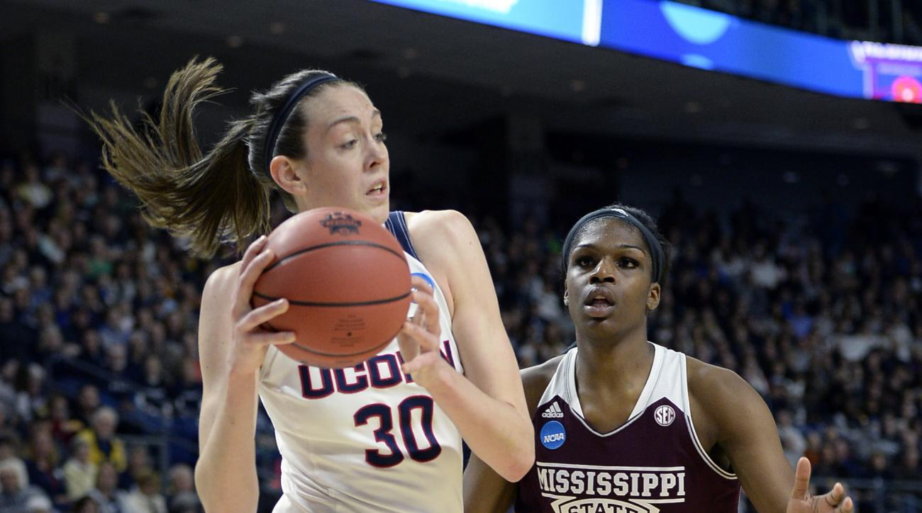 Connecticut's Breanna Stewart (30) drives past Mississippi State's Teaira McCowan during the first half of an NCAA college basketball game in the regional semifinals of the women's NCAA Tournament, Saturday, March 26, 2016, in Bridgeport, Conn. (AP Photo/