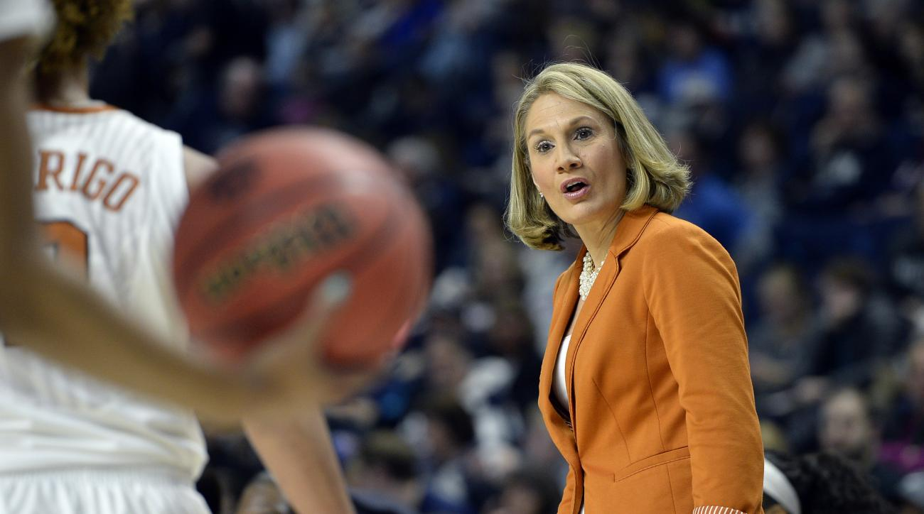 Texas head coach Karen Aston gives instruction during the first half of an NCAA college basketball game against UCLA in the first half of the regional semifinals of the women's NCAA Tournament, Saturday, March 26, 2016, in Bridgeport, Conn. (AP Photo/Jess