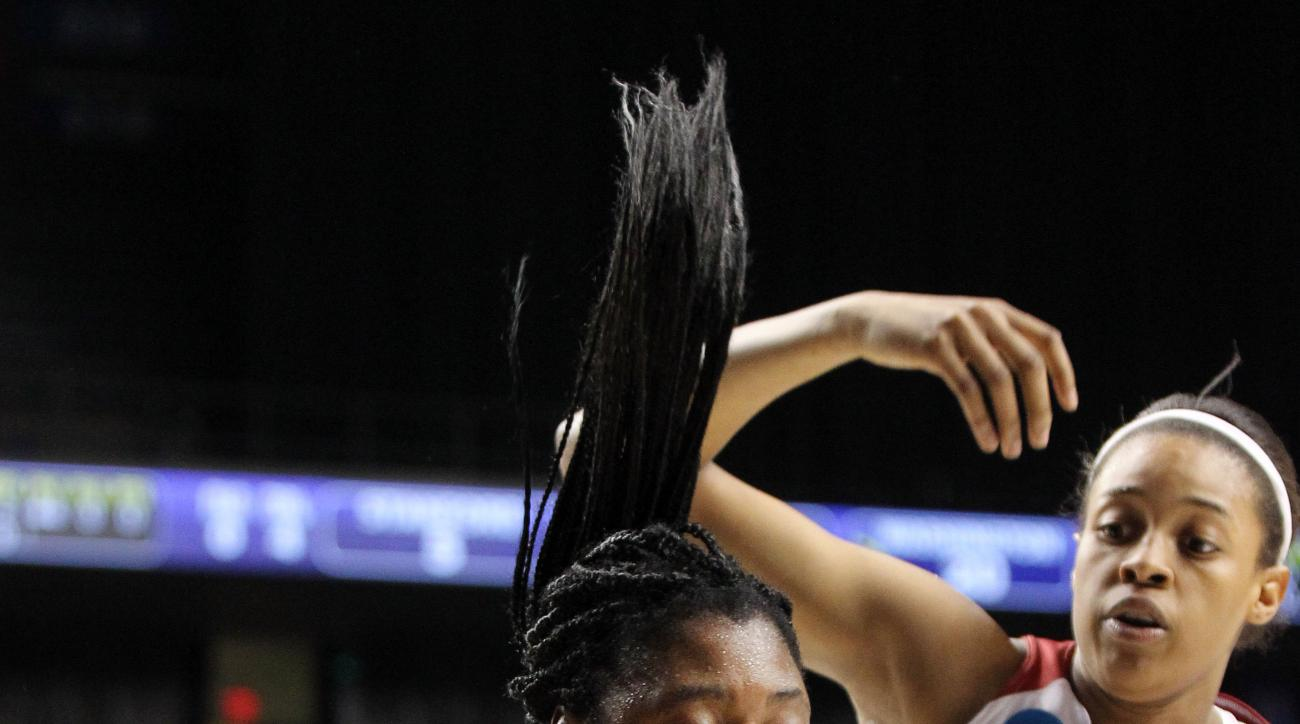 Washington's Chantel Osahor, left, pulls down a rebound near Stanford's Erica McCall (24) during a regional final women's college basketball game in the NCAA Tournament in Lexington, Ky., Sunday, March 27, 2016. (AP Photo/James Crisp)