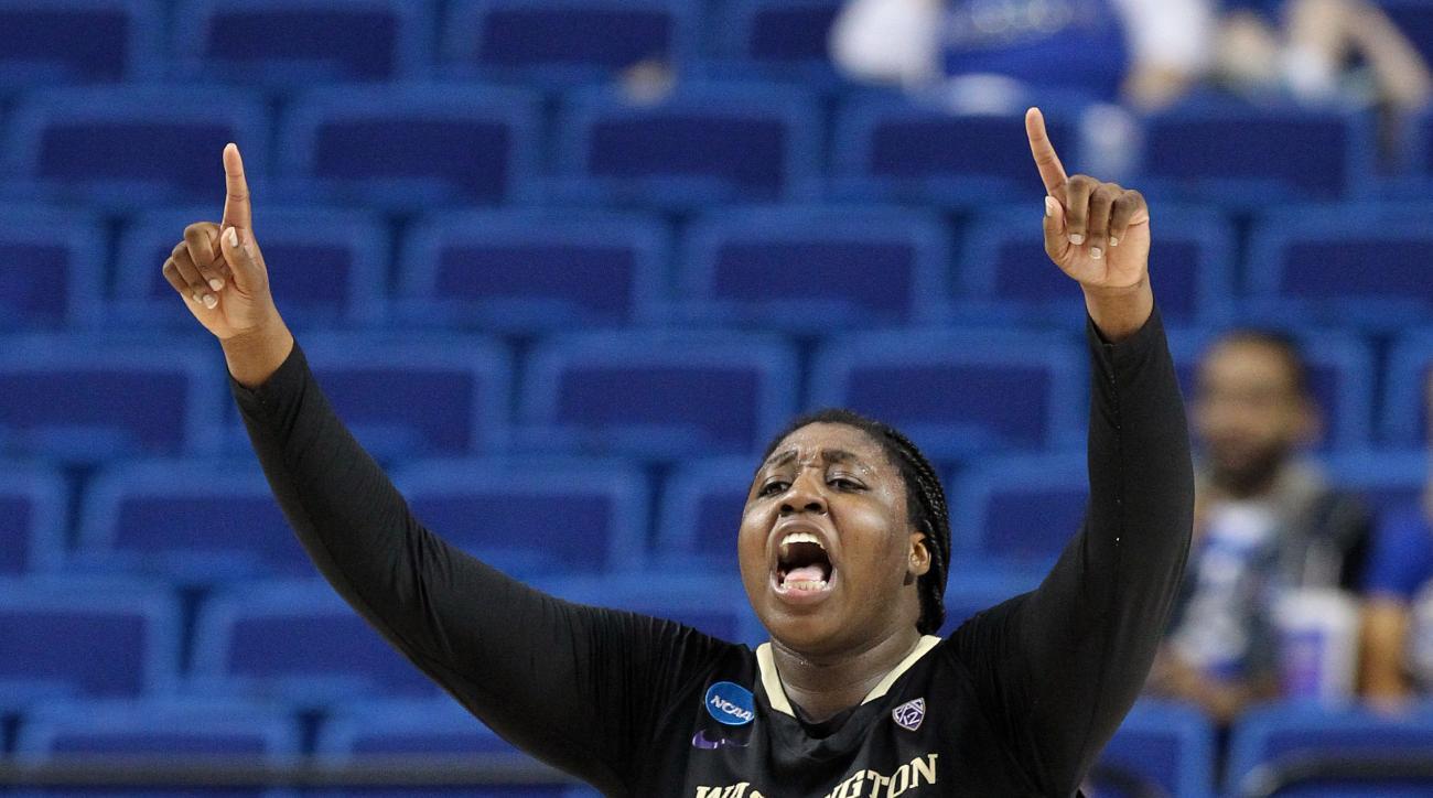 Washington's Chantel Osahor celebrates near the end of  a regional final women's college basketball game in the NCAA Tournament in Lexington, Ky., Sunday, March 27, 2016. (AP Photo/James Crisp)