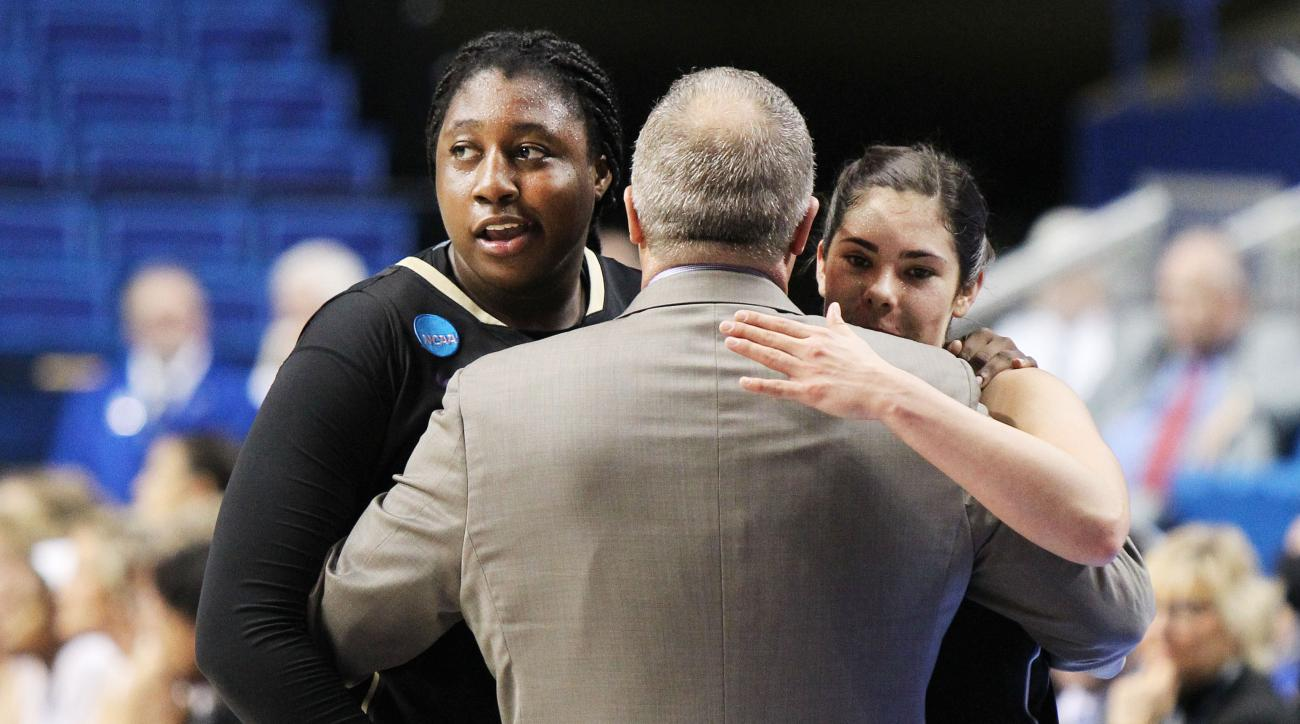 From Left, Washington's Chantel Osahor, head coach Mike Neighbors and Kelsey Plum hug in the closing moments of a regional final women's college basketball game in the NCAA Tournament against Stanford in Lexington, Ky., Sunday, March 27, 2016. Washington