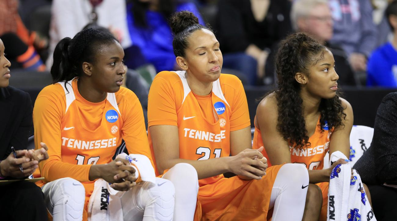 Tennessee's Meme Jackson, left, Mercedes Russell, center, and Te'a Cooper, right, react on the bench at the end of a regional final women's college basketball game against Syracuse in the NCAA Tournament, Sunday, March 27, 2016, in Sioux Falls, S.D. Syrac