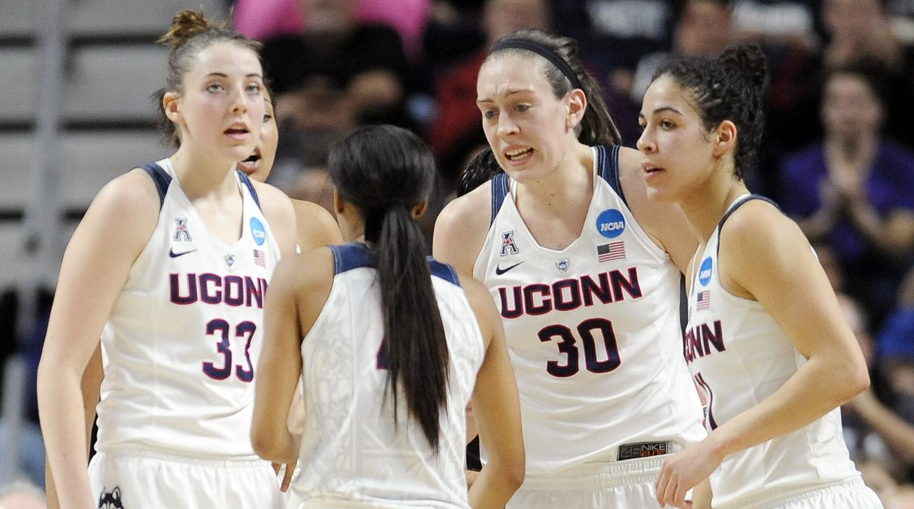 Connecticuts Breanna Stewart (30) talks to teammates Katie Lou Samuelson (33), Moriah Jefferson, second from left, and Kia Nurse, right, during the first half of a college basketball game against Texas in the regional final of the women's NCAA Tournament,