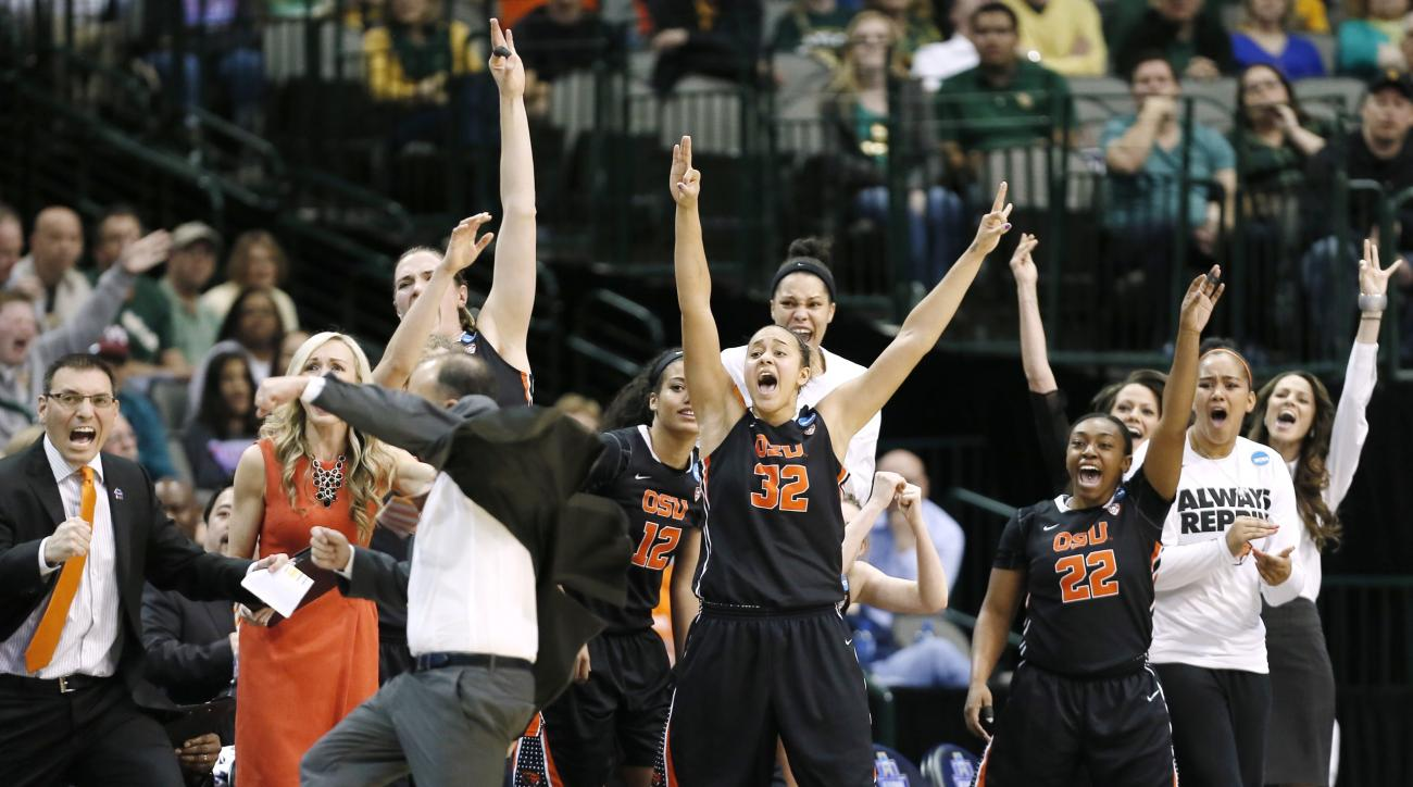 The Oregon State bench erupts on a buzzer beater shot to end the first half of a regional final of the women's NCAA Tournament basketball game against Baylor Monday, March 28, 2016, in Dallas. (AP Photo/Brandon Wade)