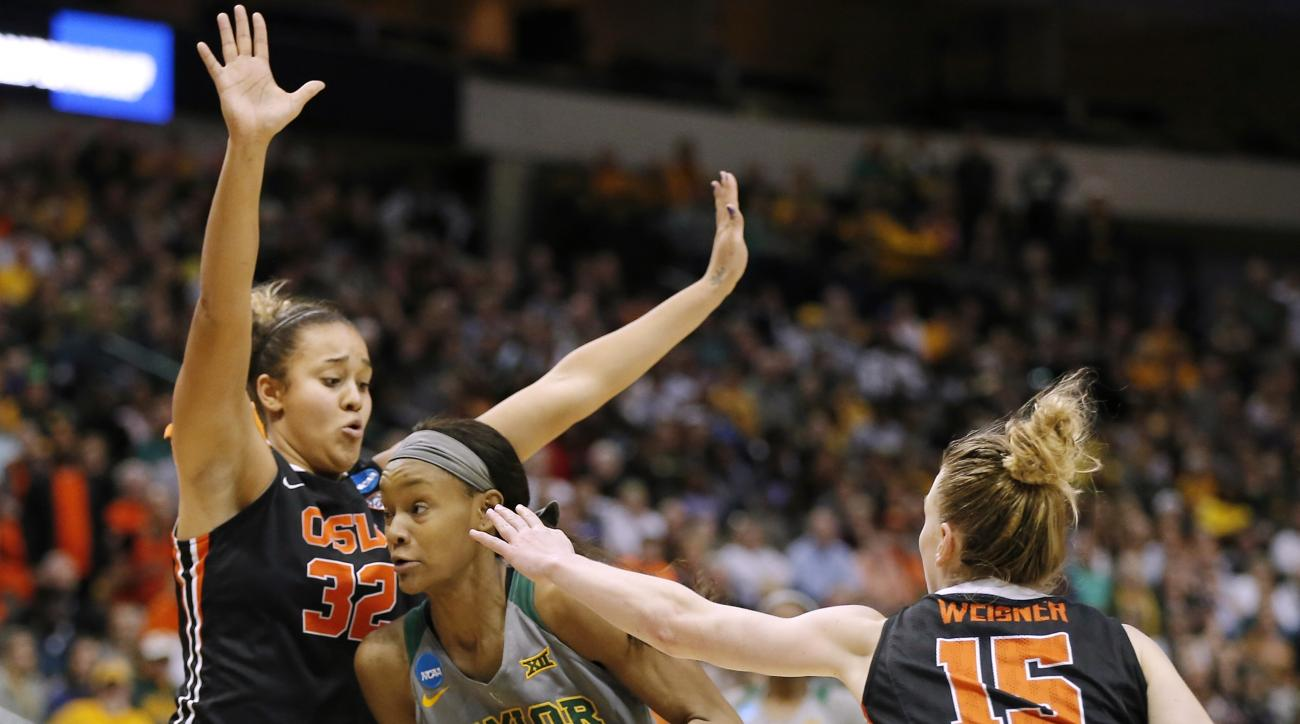 Baylor forward Nina Davis, center, battles Oregon State forwards Deven Hunter, left, and Jamie Weisner, right, for space during the second half of a regional final of the women's NCAA Tournament Monday, March 28, 2016, in Dallas. (AP Photo/Brandon Wade)