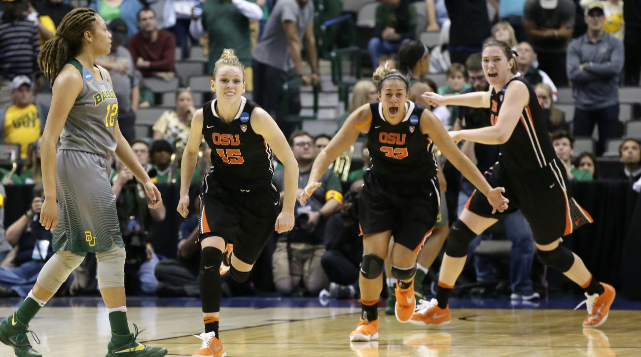 Oregon State guard Jamie Weisner (15) runs with teammates forwards Deven Hunter (32) and forward Ruth Hamblin (44) past Baylor guard Alexis Prince (12) the end of a regional final of the women's NCAA college basketball tournament, Monday, March 28, 2016,